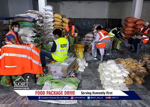 team preparing food packages