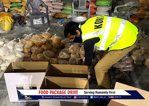 KORT volunteer preparing packages to distribute