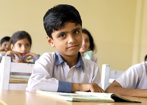 Child in classroom at KORT complex
