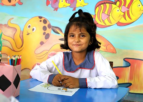 Colouring at KORT school, sponsor towards an orphan